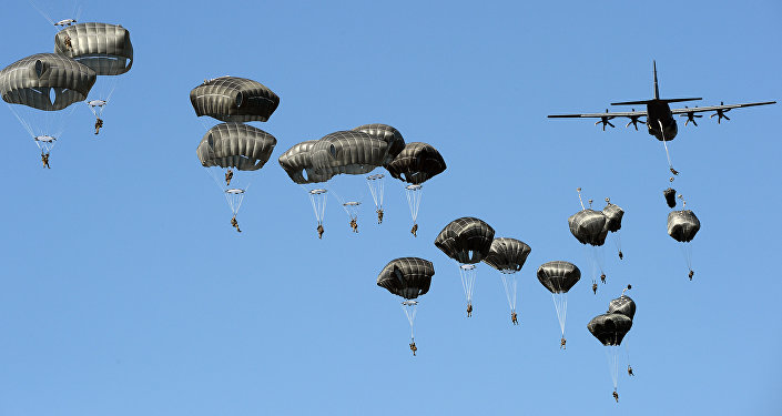 US troops land with parachutes at the military compound near Torun, central Poland, on June 7, 2016, as part of the NATO Anaconda-16 military exercise