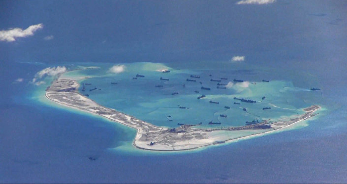 Chinese dredging vessels in the waters around Mischief Reef in the disputed Spratly Islands in the South China Sea in this still image from video taken by a P-8A Poseidon surveillance aircraft provided by the United States Navy May 21, 2015.