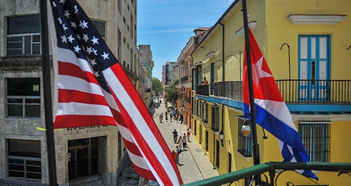 Cuban and US flags are seen outside the private restaurant La Moneda Cubana in Havana on March 17, 2016