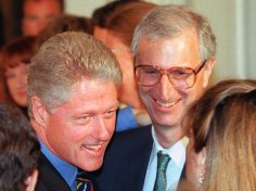 US President Bill Clinton (L) and presidential advisor Ira Magaziner (R) greet guests during an electronic commerce event 01 July at the White House in Washington, DC on July 1, 1997. Clinton hosted the event which promotes commerce on an international scale using the internet