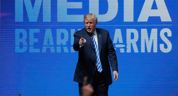U.S. President Donald Trump gestures after speaking at a National Rifle Association (NRA) convention in Dallas, Texas, U.S. May 4, 2018