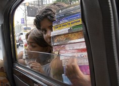 Boys selling pirated books in India image