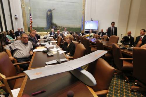 A remote control airplane sits on a table at the State Capitol during a committee meeting to discus concerns about the growing drone industry in Oklahoma City, Thursday September  26, 2013. Photo By Steve Gooch, The Oklahoman <strong>Steve Gooch - The Oklahoman</strong>
