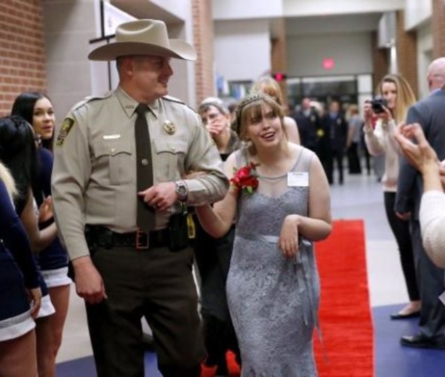 Canadian County Sheriff Deputy David Cates Escorts Alyssa Wilson Down The Red Carpet Friday During Night To Shine At Lincoln Learning Center In El Reno