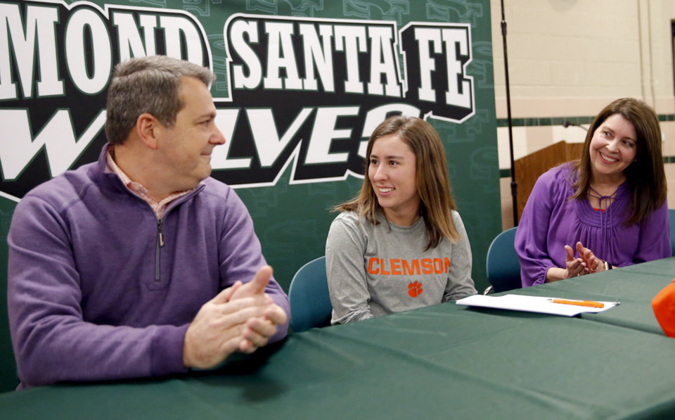 Photo - Catherine O'Keefe waits to speak as her parents Lisa and Mike look on during signing day ceremony at Edmond Santa Fe High School in Edmond, Okla., Wednesday, Feb. 6, 2019. Photo by Sarah Phipps, The Oklahoman