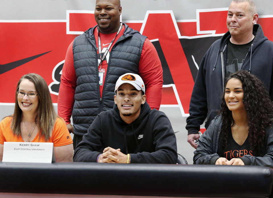 Photo - Kerry Shaw poses after putting a ball cap from East Central University after signing letter to play at the Ada school during Signing Day event at Westmoore High School on Wednesday, Feb. 6, 2019.  Photo by Jim Beckel, The Oklahoman.