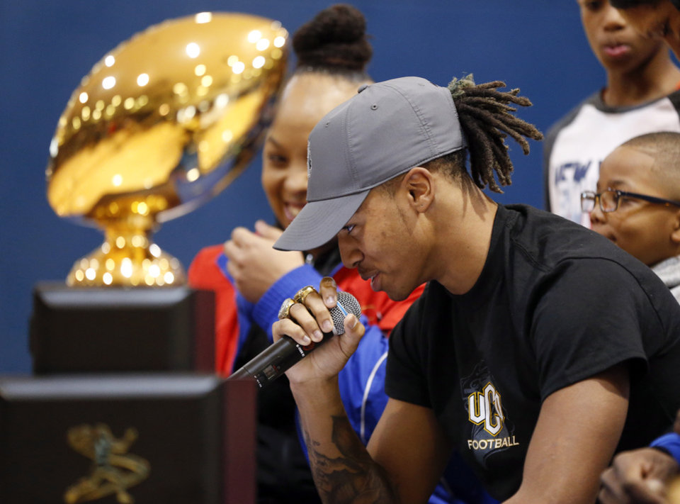Photo - Millwood's Dontez Fagan speaks during the signing ceremony for high school football players in the Millwood Field House in Oklahoma City, Wednesday, Feb. 6, 2019. Fagan will play football at UCO. Photo by Nate Billings, The Oklahoman