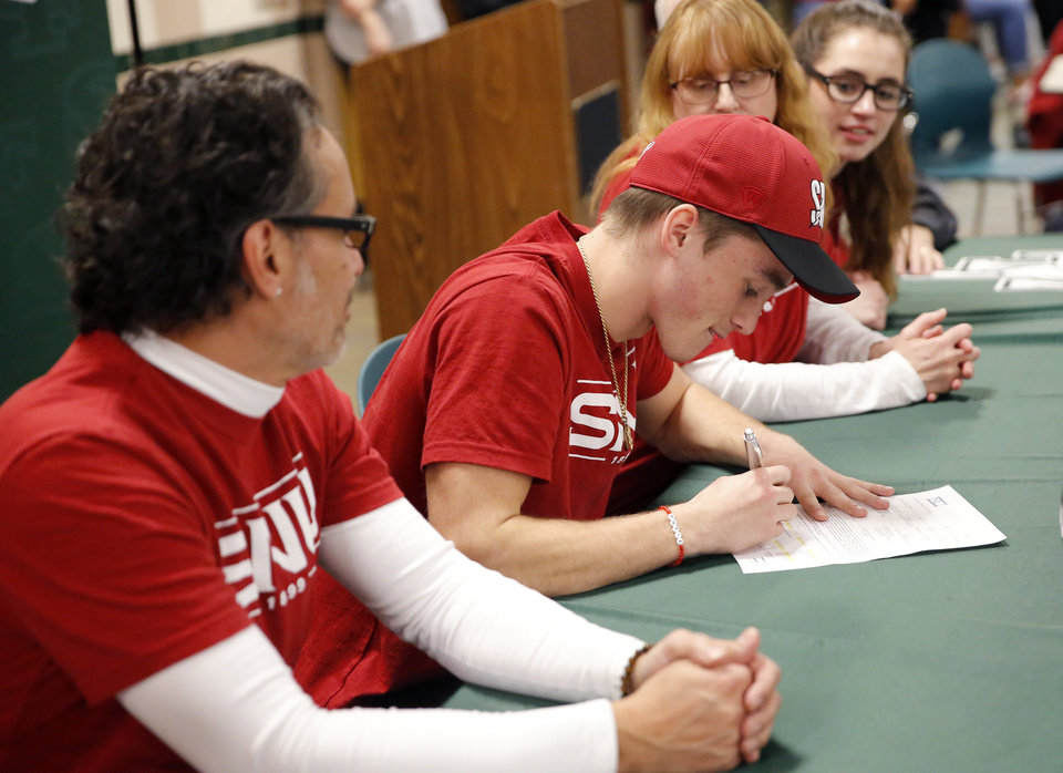 Photo - Nieko Nieves signs to play football at SNU during signing day ceremony at Edmond Santa Fe High School in Edmond, Okla., Wednesday, Feb. 6, 2019. Photo by Sarah Phipps, The Oklahoman