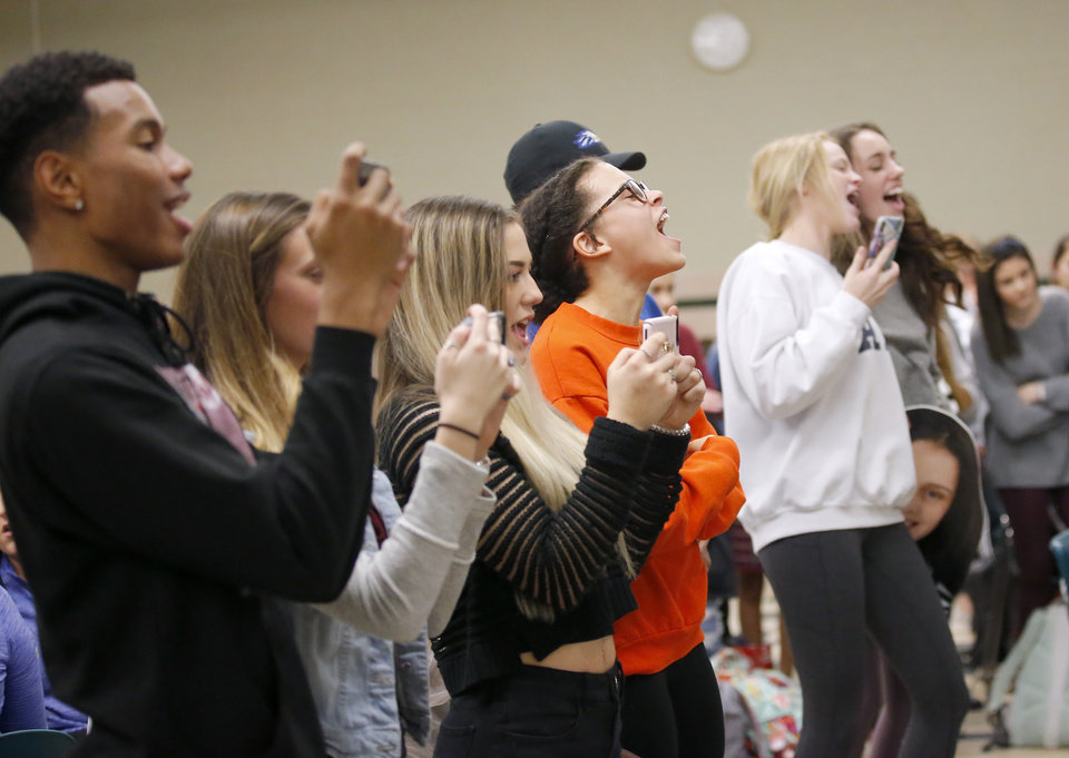 Photo - Friends cheer for Karson Merrell as she signs to play golf at SW Christian University during signing day ceremony at Edmond Santa Fe High School in Edmond, Okla., Wednesday, Feb. 6, 2019. Photo by Sarah Phipps, The Oklahoman