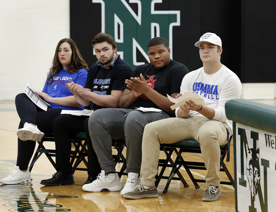 Photo - Athletes signing letters during Signing Day event at Norman North High School on Wednesday, Feb. 6, 2019, are, from left, Alex Martin (softball), Blake Yohn (Track/Cheer), Ja'Vion Combs (football) and Bo Kemmet (football).  Photo by Jim Beckel, The Oklahoman.