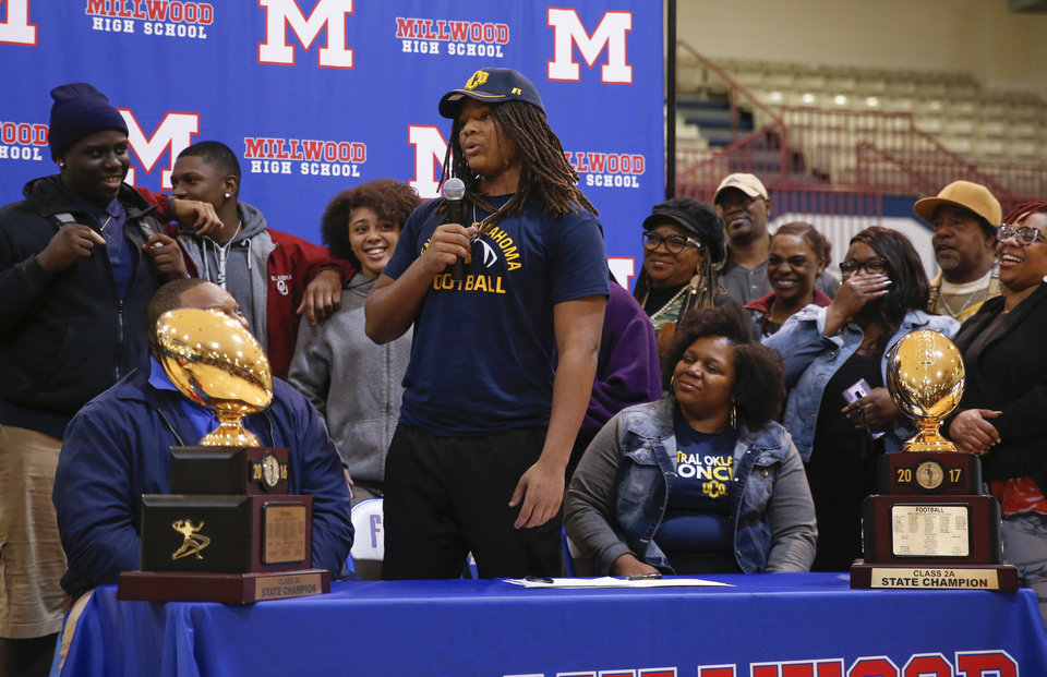Photo - Millwood's Isaiah Major speaks surrounded by his family during the signing ceremony for high school football players in the Millwood Field House in Oklahoma City, Wednesday, Feb. 6, 2019. Isaiah Major will play football at UCO. Photo by Nate Billings, The Oklahoman