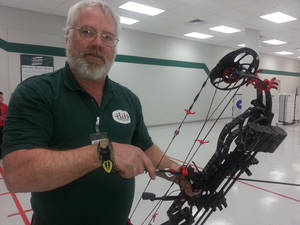 Photo -  Steve Levering, manager of the archery department at H&H Shooting Sports. Photo By Ed Godfrey, The Oklahoman  <strong>  </strong>