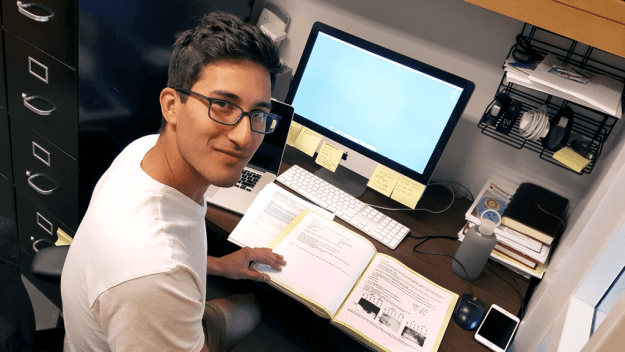 Brooke Herrera copies data from his notebook to a computer file.