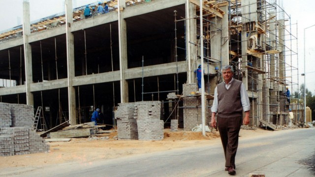 Dr. Max Essex at the construction site for the Botswana-Harvard Partnership, Gaborone, Botswana, 2000.