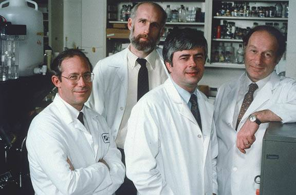 William Haseltine, Jerome Groopman, Max Essex, Martin Hirsch in lab coats in 1986