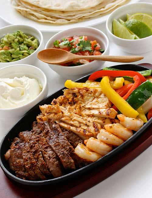 Beef, Chicken, And Shrimp Fajitas