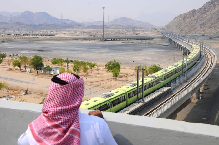 A Saudi man looks over a new monorail connecting the holy sites of Mecca and Medina in 2010 (AMER HILABI/AFP/Getty)