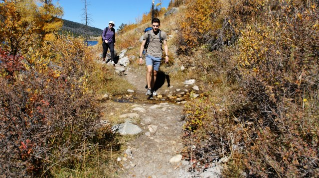 Zachary and Estelle hiking on the trail.