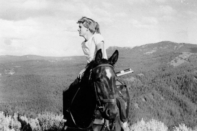Fenn sits on a horse overlooking nature.