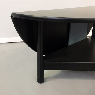 italian matt black solid wood oval coffee table with book opening 1980s