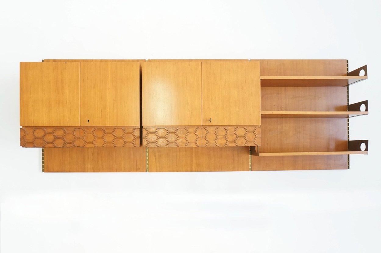 bibliotheque suspendue murale avec meubles et tiroirs de la permanente mobili cantu italie 1960s