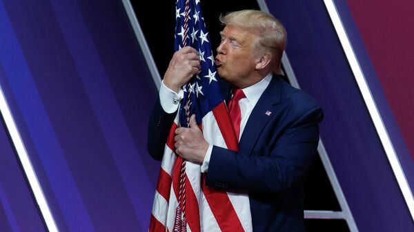 The President of the United States Donald trump kisses the American flag after a speech at a conference of the conservative political action