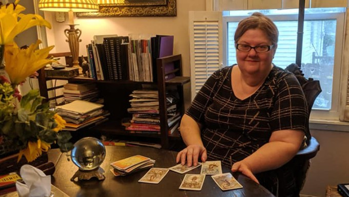 Vianne, pet psychic, sits with tarot cards