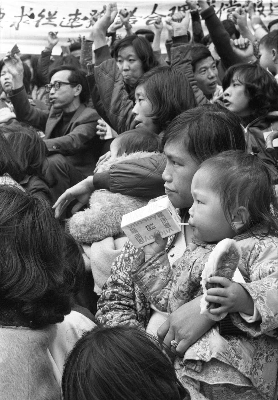 A toddler drinks Vitasoy as residents from a Kowloon Bay temporary housing area who were made homeless by a fire stage a rally outside the Housing Department headquarters in Ho Man Tin to press for rehousing and compensation, in this photo from 1978. Photo: SCMP