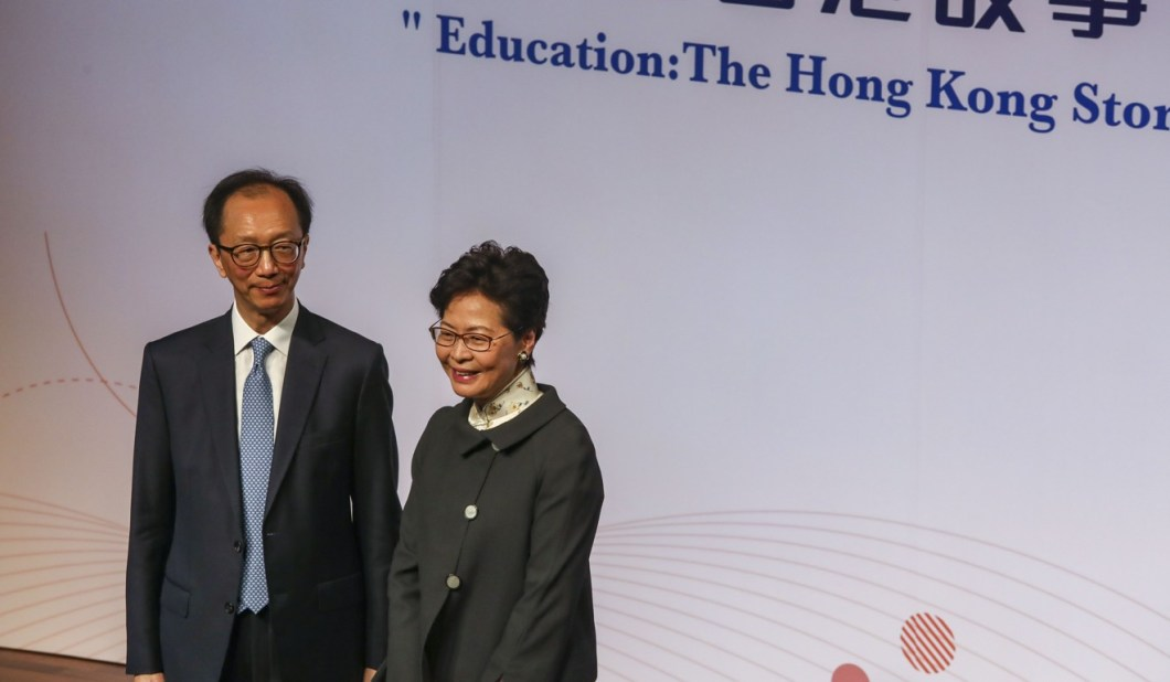 Antony Leung, group chairman of New Frontier, and Chief Executive Carrie Lam share the stage at the University of Hong Kong. Photo: Jonathan Wong