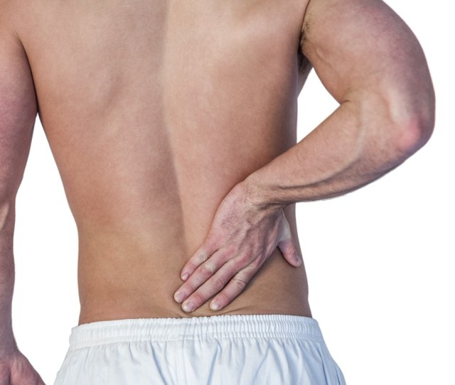 A Man Suffering From Back Pain Photo Wavebreakmedia