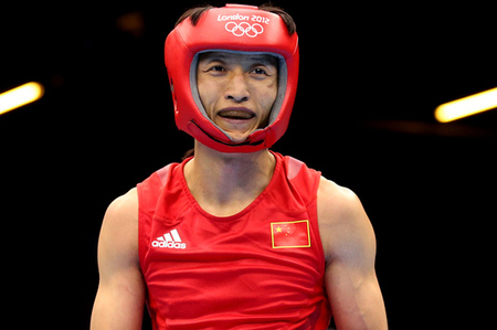 China's Zou Shiming won the light flyweight gold medal in boxing, repeating his feat from 2008. (Photo by Scott Heavey/Getty Images)