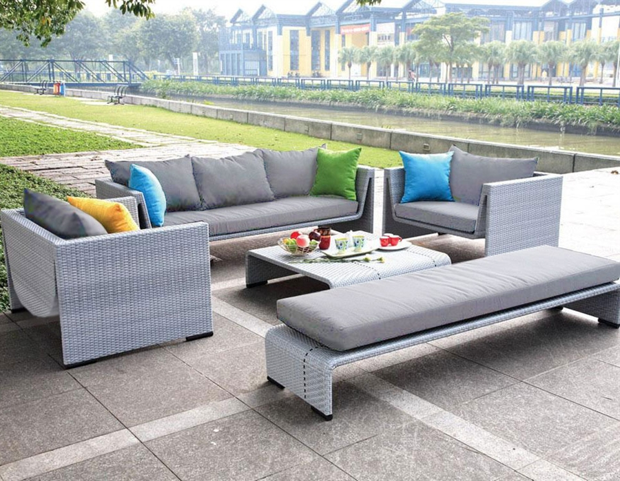 modern outdoor patio set with lounge chaise and table