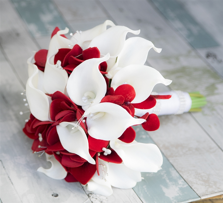 real touch calla lilies with lots of red fillers and bling silk wedding bouquet