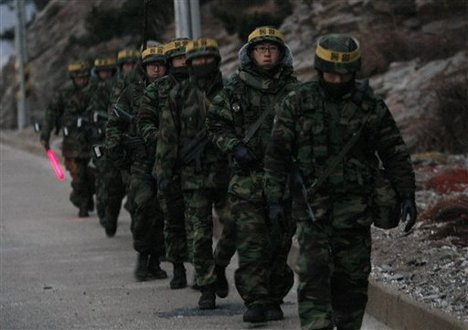 South Korean marines patrol on Yeonpyeong island, South Korea, Sunday, Dec. 19, 2010. Military maneuvers planned by South Korean troops did not take place Saturday because of bad weather on the border island shelled by North Korea last month, but the U.N. Security Council scheduled an emergency meeting at Russia's request amid concerns over rising tensions on the divided peninsula.