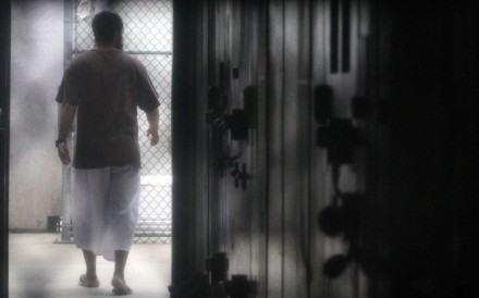A prisoner walks around a communal cellblock in the US Navy base at Guantanamo Bay, Cuba. Photo: AFP