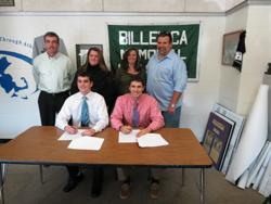 D.J. Smith, joined by his parents, sits with UMass-Lowell baseball signee Max Frawley and his parents