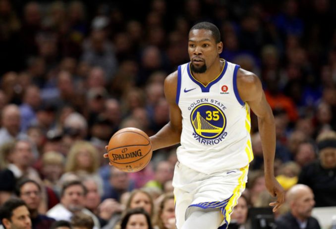 Kevin Durant dribbles the ball.