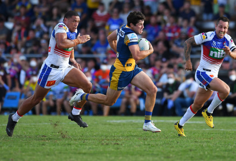 Mitchell Moses breaks away.