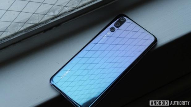 Huawei P20 Pro reflecting in window - Huawei P30 and P30 Pro rumors