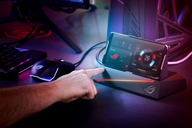Asus Rog gaming phone being used with a PC setup.