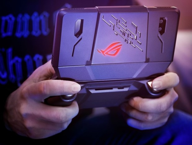 Asus Rog Phone gaming smartphone in hands from behind.