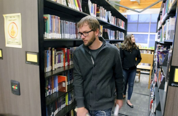 Former library director Adam Winger in a library.