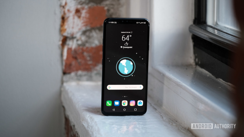 LG V40 ThinQ sitting on a window showing home screen