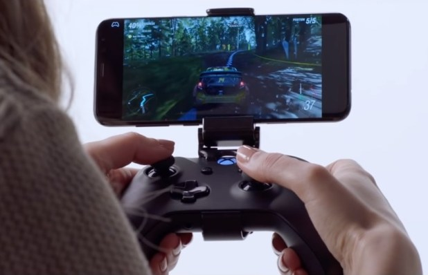 An image of a woman playing a handheld game via Project xCloud, a new game streaming service from Microsoft.