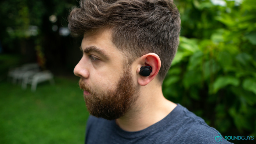 Adam wearing the Samsung Gear IconX, which are too expensive to be cheap true wireless earbuds.