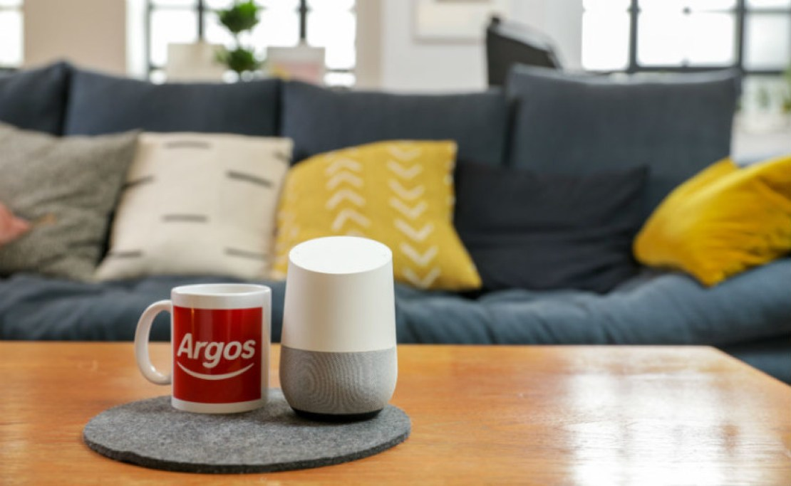 Argos logo on mug next to Google Home smart speaker - Black Friday