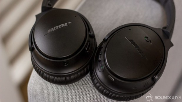 Bose QuietComfort 35 II image on a grey couch arm.