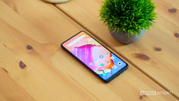 Xiaomi Mi Mix 3 on table with screen turned on.