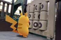 This is a photo of Pikachu at a playground for the best pokemon go iv calculators for android