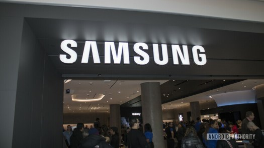 A view of the Samsung Experience Store in Long Island, from the outside looking in. The Samsung logo is above the entry.